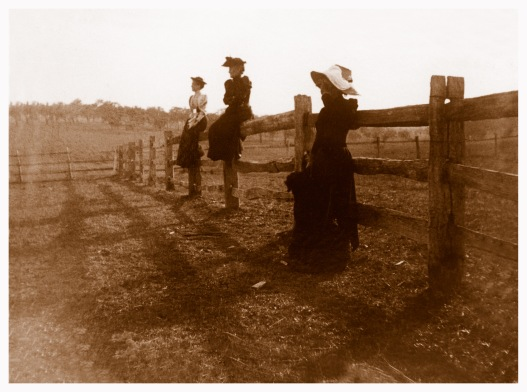 Wragge women on a post and rail fence. Picture taken probably in the fields that later became the Simpson Barracks, Yallambie, (Bill Bush Collection).